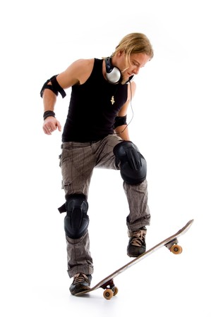 19 years old: male riding on skate board against white background Stock Photo