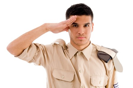 saluting: portrait of saluting soldier on an isolated white background