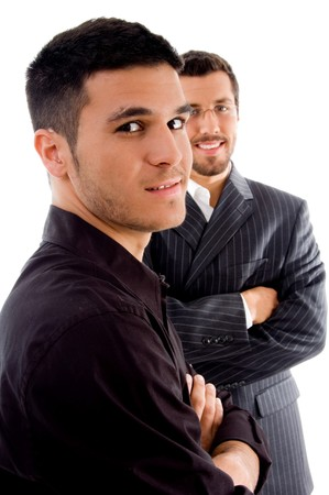 successful young executives posing with crossed arms against white background photo