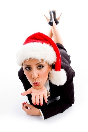 young employee with christmas hat giving flying kiss against white background photo
