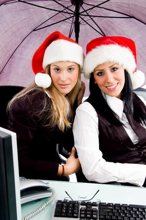 businesspeople in christmas hat against white background photo