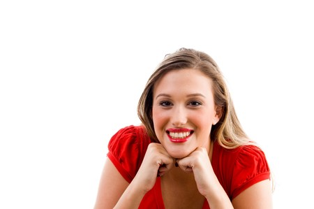 21: female model posing with her chin on fists on an isolated white background