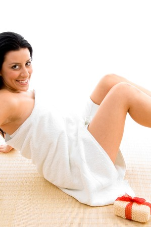 scrubber: side view of smiling sexy woman with scrubber in spa