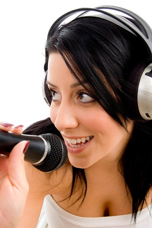 top view of young woman with headphone and microphone on white background photo