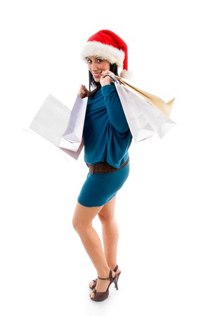 side pose of christmas woman holding bags with white background photo