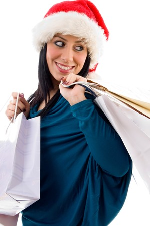 side pose of christmas woman holding bags on an isolated background photo