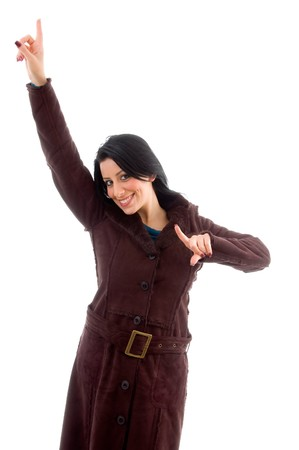front view of smiling pointing female wearing overcoat on an isolated white background Stock Photo - 4051417