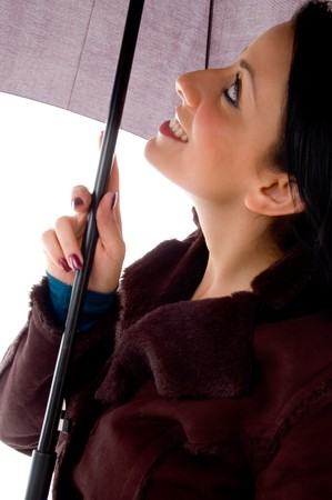 side view of smiling woman looking umbrella with white background photo