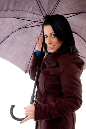 side view of smiling woman holding umbrella on an isolated background photo