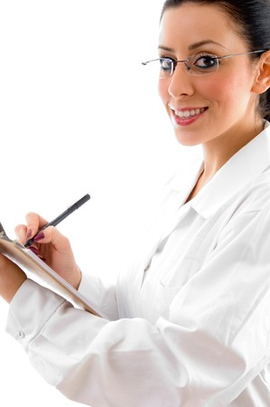 side pose of doctor with writing pad and pen against white background photo