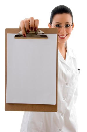 front view of smiling doctor showing writing pad with white background