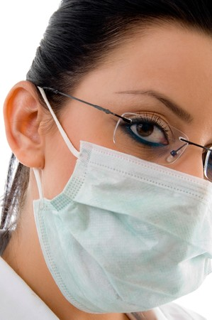 close view of female doctor wearing mask and eyewear