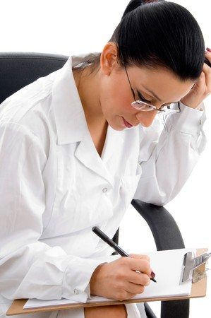 side view of female doctor doing work on an isolated white background photo
