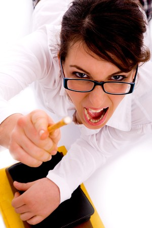 high angle view of shouting female pointing with pencil with white background photo