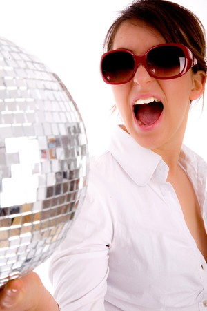 side pose of shouting woman holding disco ball on an isolated background photo