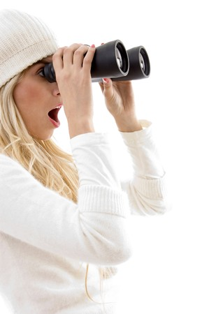 side view of amazed woman looking through binoculars on an isolated background Stock Photo - 4102228
