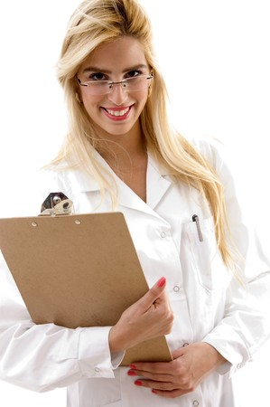 portrait of smiling female doctor holding clipboard on an isolated background photo