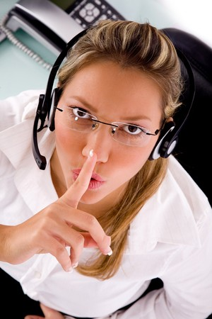 top view of service provider instructing to be silent in an office Stock Photo - 4102421