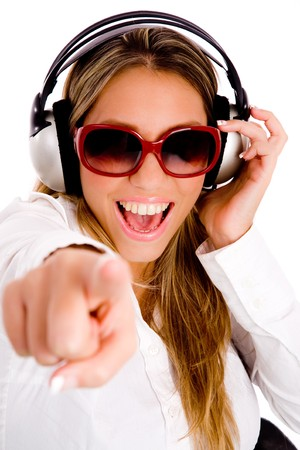 front view of pointing female enjoying music on an isolated background Stock Photo