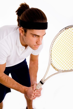 side pose of male playing tennis on an isolated background photo