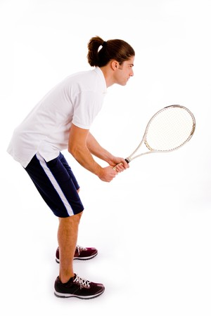 side view of man playing tennis with white background photo