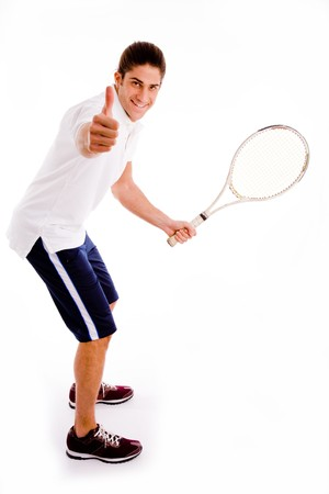 side view of tennis player with thumbs up against white background