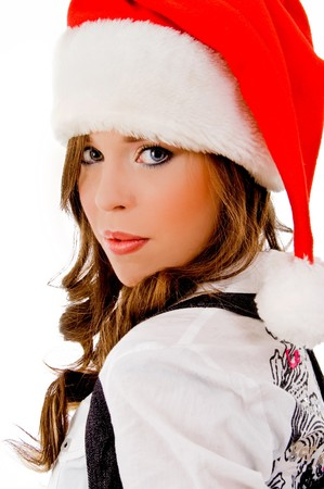 sidepose of cheerful christmas woman against white background photo