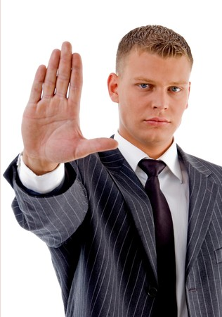 stopping: young manager showing stopping gesture with white background Stock Photo