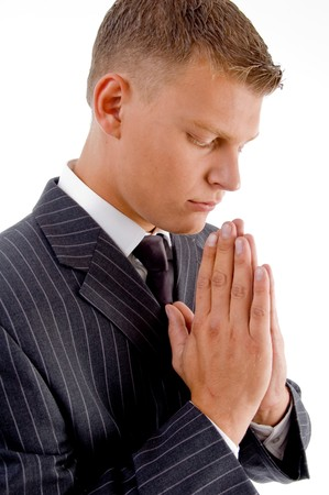 side pose of praying businessman against white background Stock Photo - 4360560