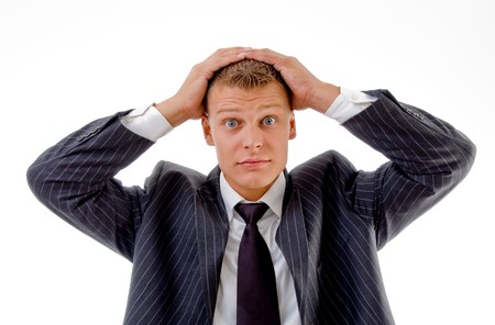 portrait of confused businessman on an isolated white background