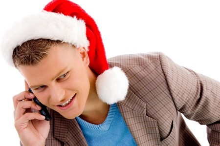 handsome man with christmas hat talking on mobile with white background photo