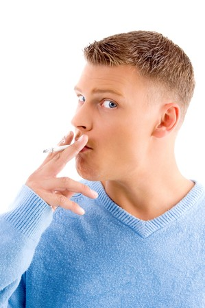 side view of smoking adult man on an isolated white background