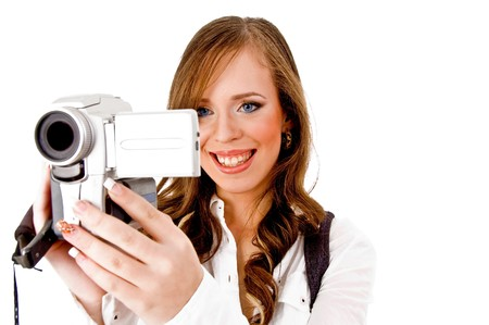 portrait of smiling female carrying videocamera on an isolated white background photo