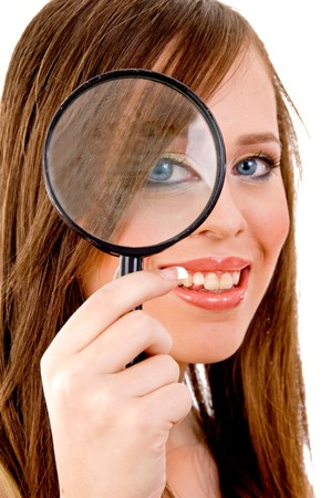front view of woman looking through lens on an isolated background photo