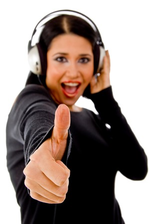 young female listining music against white background photo