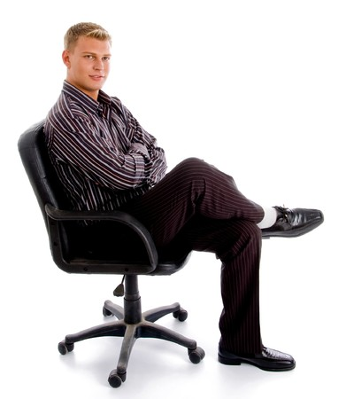 full pose of stylish successful person sitting on the chair against white background Standard-Bild