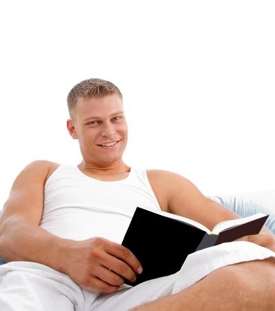 man enjoying reading in bed on white background photo