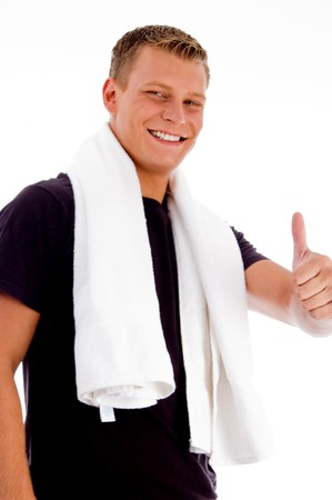 goodluck: muscular male showing thumbs up on an isolated background Stock Photo