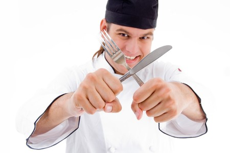 male chef holding knife and fork on an isolated white background photo
