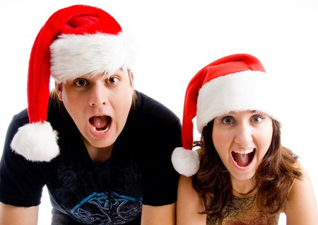 portrait of shouting couple wearing christmas hat on an isolated background photo