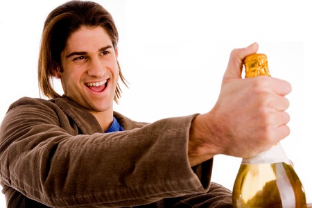 portrait of man holding champagne bottle against white background photo
