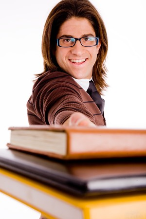 portrait of smiling student showing books on an isolated background Stock Photo - 4416362