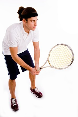 side pose of young tennis player against white background photo