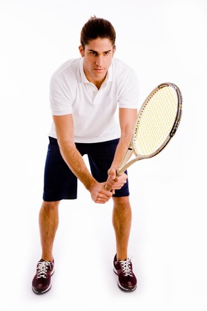 front view of player holding racket with white background