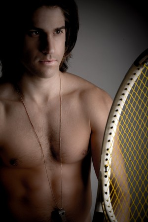 front view of shirtless man holding racket on an isolated background photo