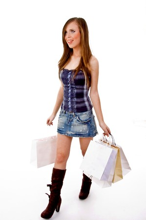 21: side view of female carrying bags and looking up with white background Stock Photo