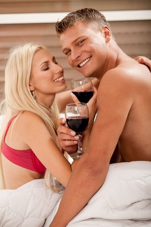 Couple sharing wine in bed Stock Photo - 5107959