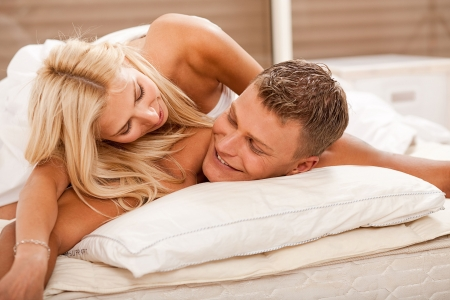 man and woman sex: Couple having fun in bed