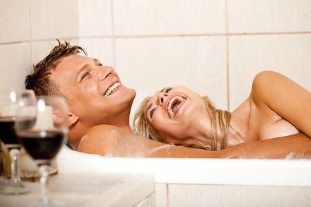 sexy bath: Happy couple bathing Stock Photo