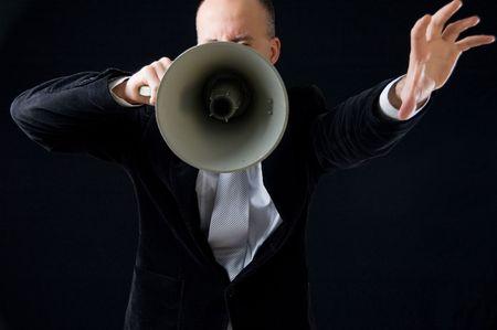 making an announcement: Businessman making announcement Stock Photo